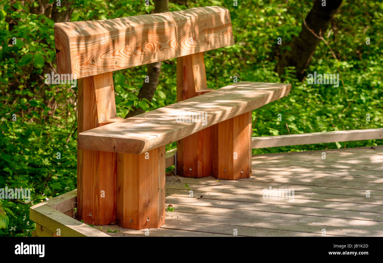 Wooden Bench On Wooden Walkway Play Of Light On Ground And Stock