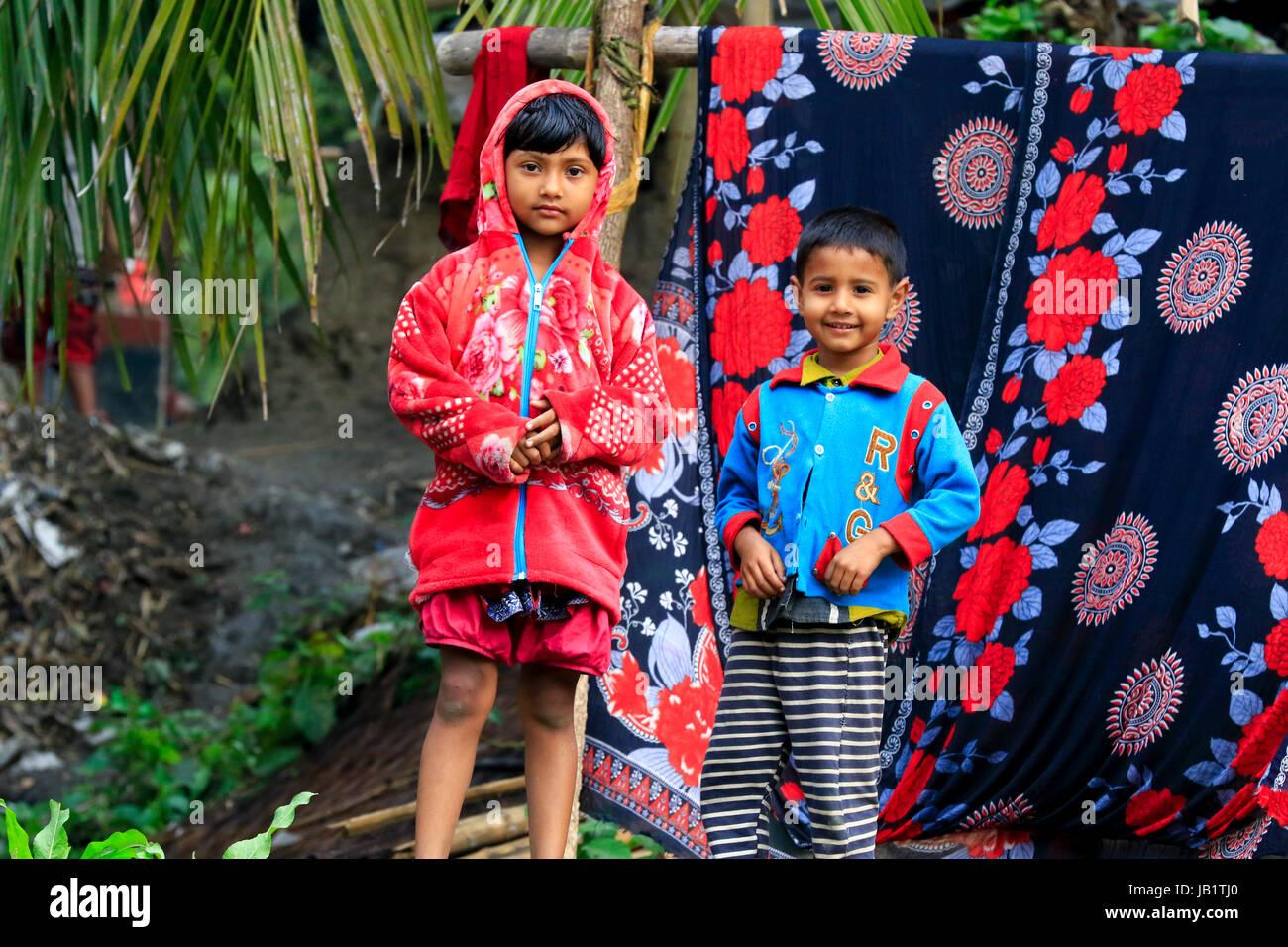 Bangladeshi rural boy and girl. Narail, Bangladesh. - Stock Image