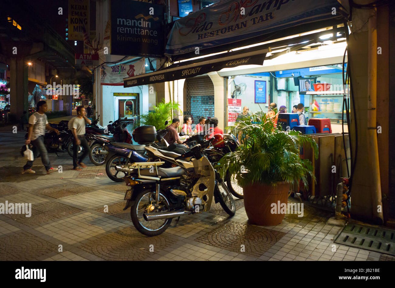 Roadside café in evening in Chow Kit, Kuala Lumpur, Malaysia - Stock Image