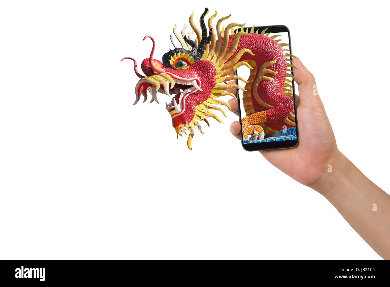 human hand hold smartphone, tablet, cell phone with big dragon statue come out screen. concept of celebrate Chinese - Stock Image