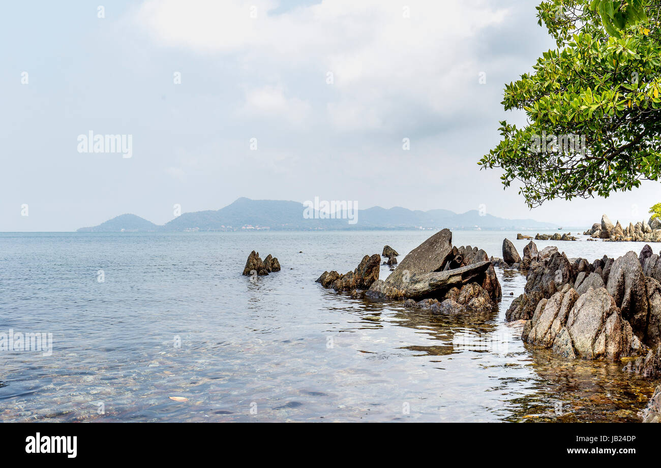 Natural landscape of rabbit island in Kep Beach Cambodia with rocks leaves - Stock Image