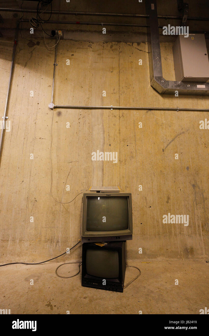 Two old computer monitors in an underground bunker. - Stock Image