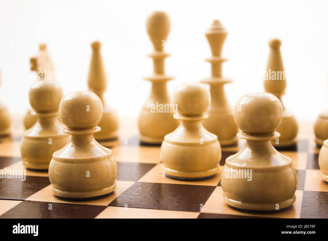 chess pieces on a board in different compositions stock photo