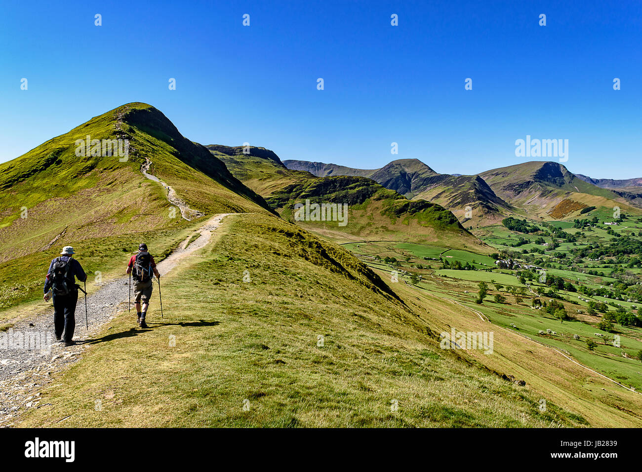 Walkers heading up Catbells near Keswick in the Lake District national park - Stock Image