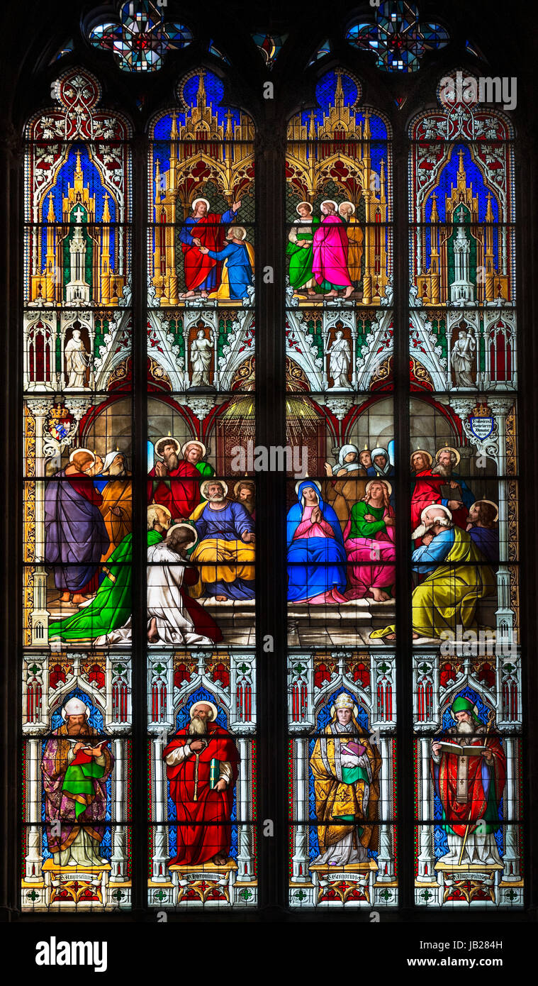 Stained glass window. The Pentecost window (1848) showing the descent of the Holy Spirit on the day of Pentecost, - Stock Image