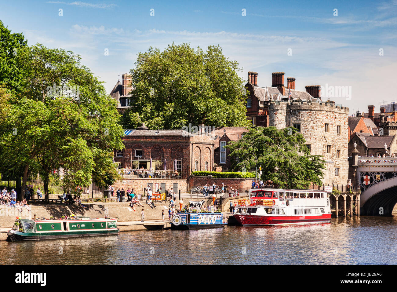 31 May 2017: York, North Yorkshire, England, UK - Pleasure boats at Lendal Bridge Landing, with crowds of tourists - Stock Image