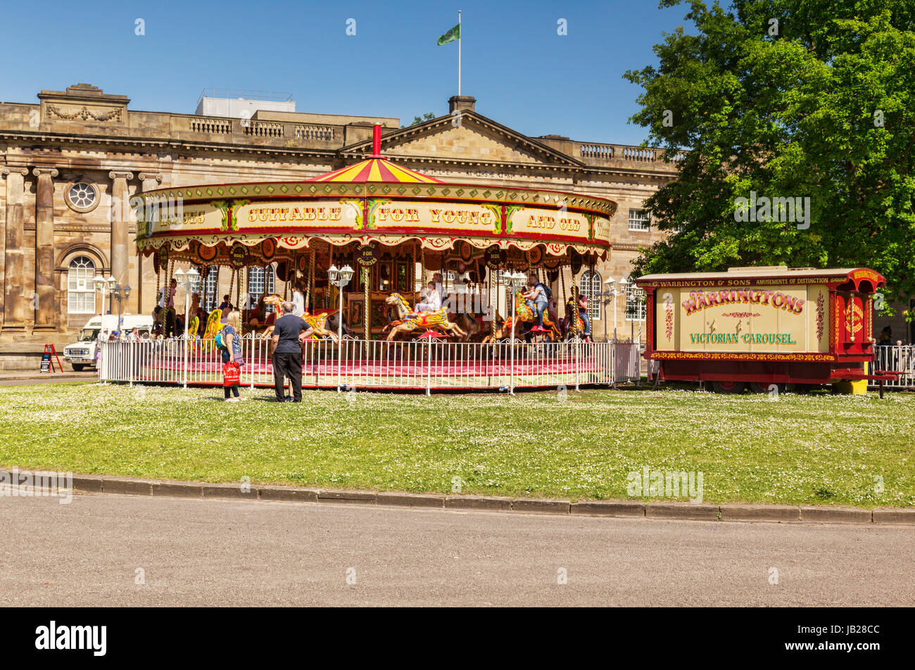31 May 2017: York, North Yorkshire, England, UK - A Victorian Carousel on the grass in front of the Castle Museum. - Stock Image