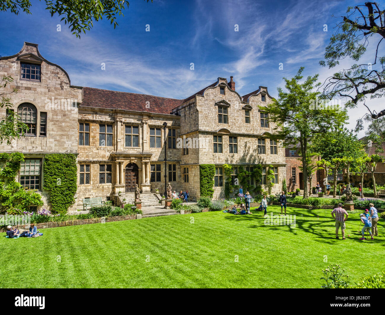 31 May 2017: York, North Yorkshire, Wngland, UK - The Treasurers House, with people playing croquet on the lawn. - Stock Image