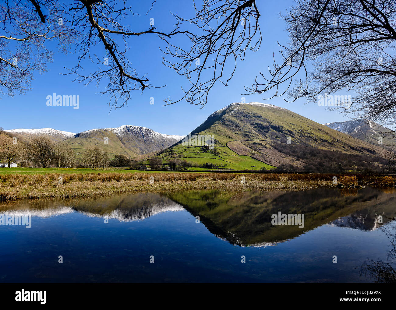 Hartsop Dodd reflected in Brothers Water - Stock Image