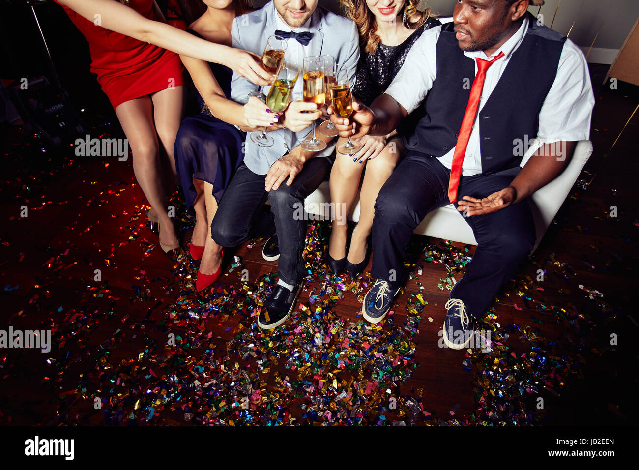 Celebrating Momentous Event at Night Club Stock Photo