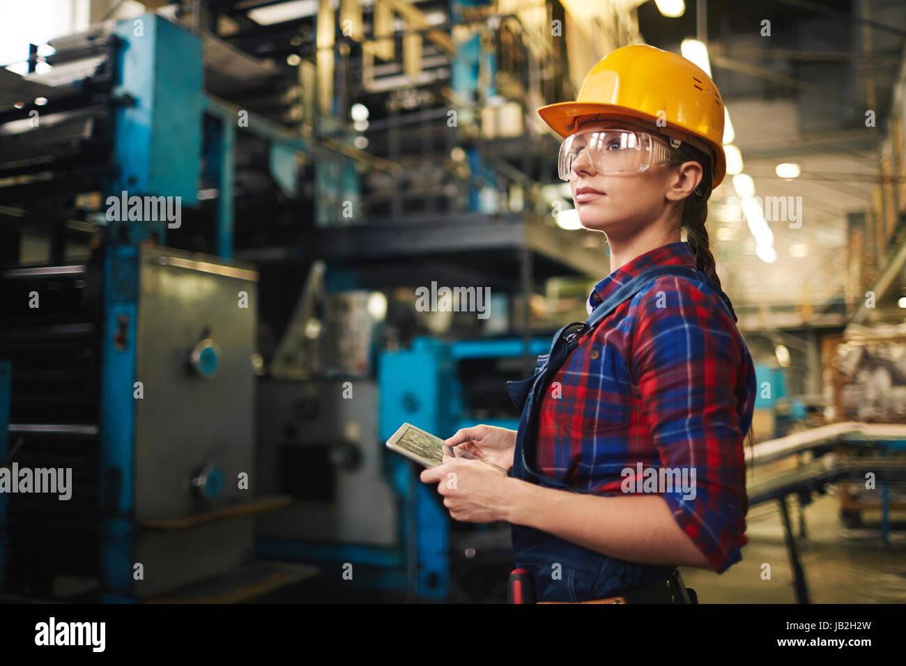 Female Employee Doing Checklist - Stock Image
