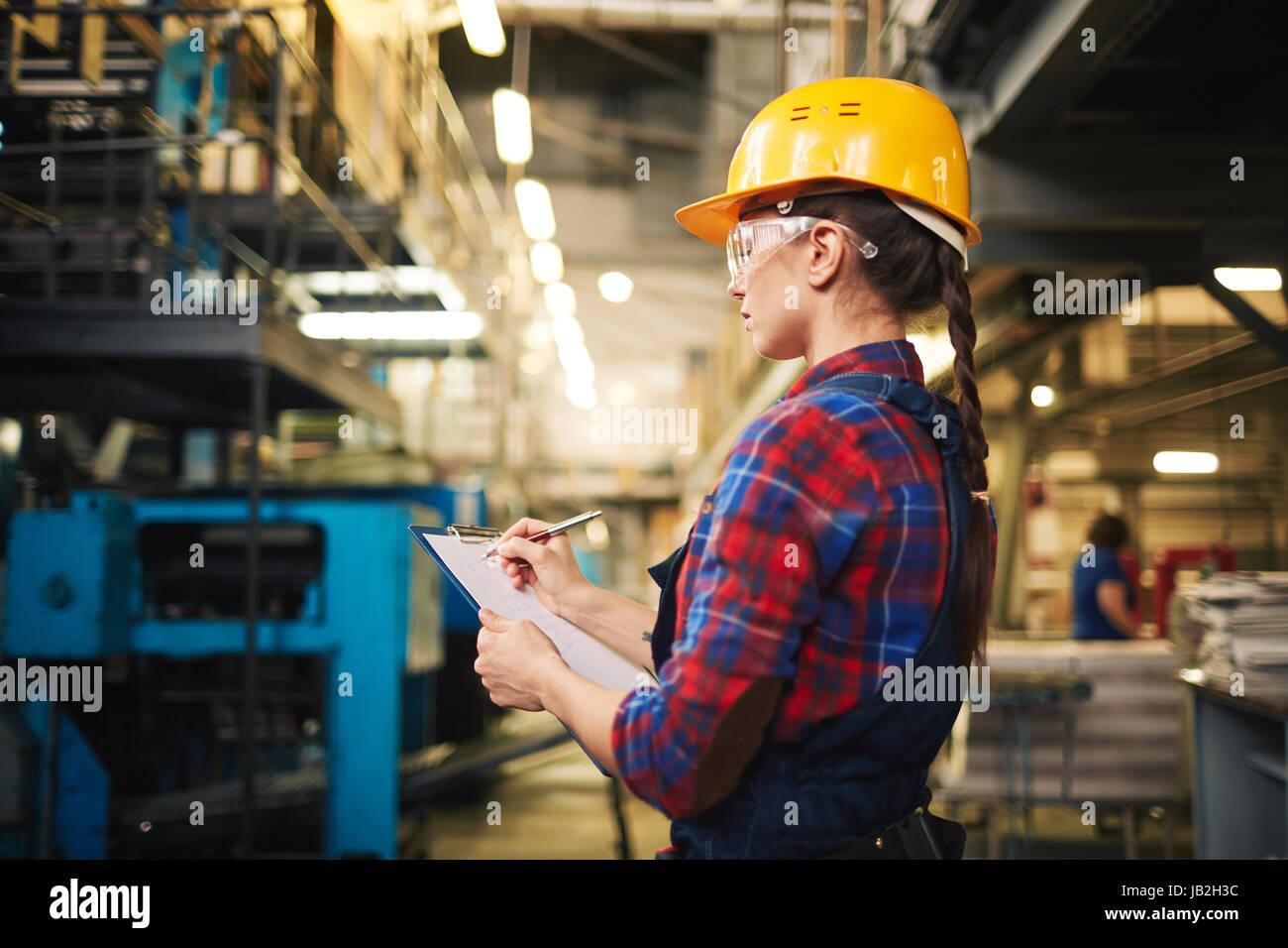 Examining Equipment in Plant - Stock Image