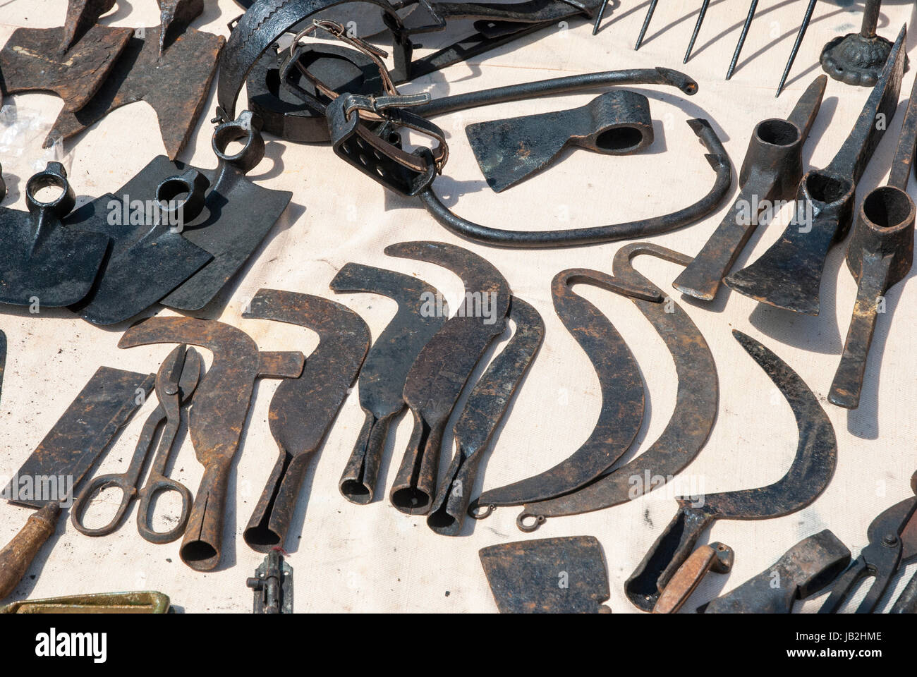 Various rusted vintage metal tools - hammer, pliers, chisels Stock Photo