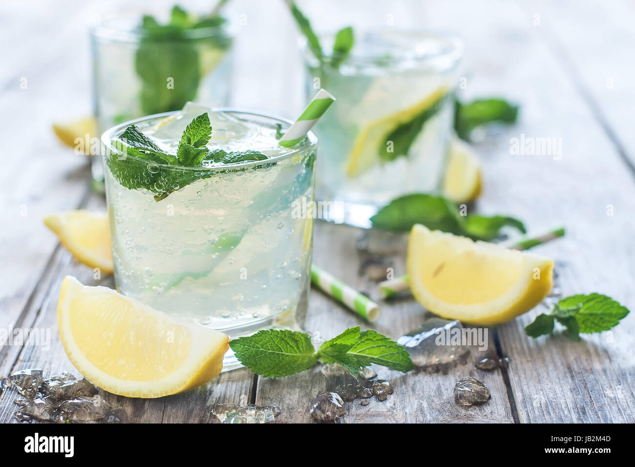 Chilled mint lemonade with mint leaves and fresh lemon - Stock Image