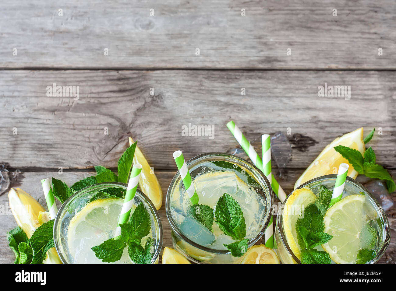 Chilled mint lemonade with mint leaves and fresh lemon. Copy space background. - Stock Image