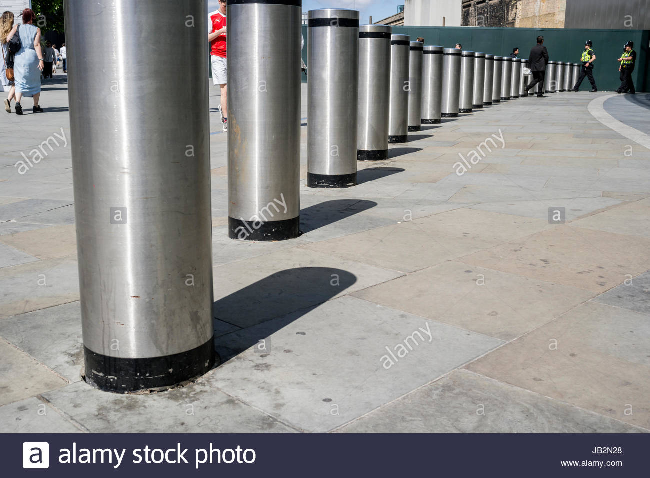 Steel bollards outside Kings Cross Railway Station - Stock Image
