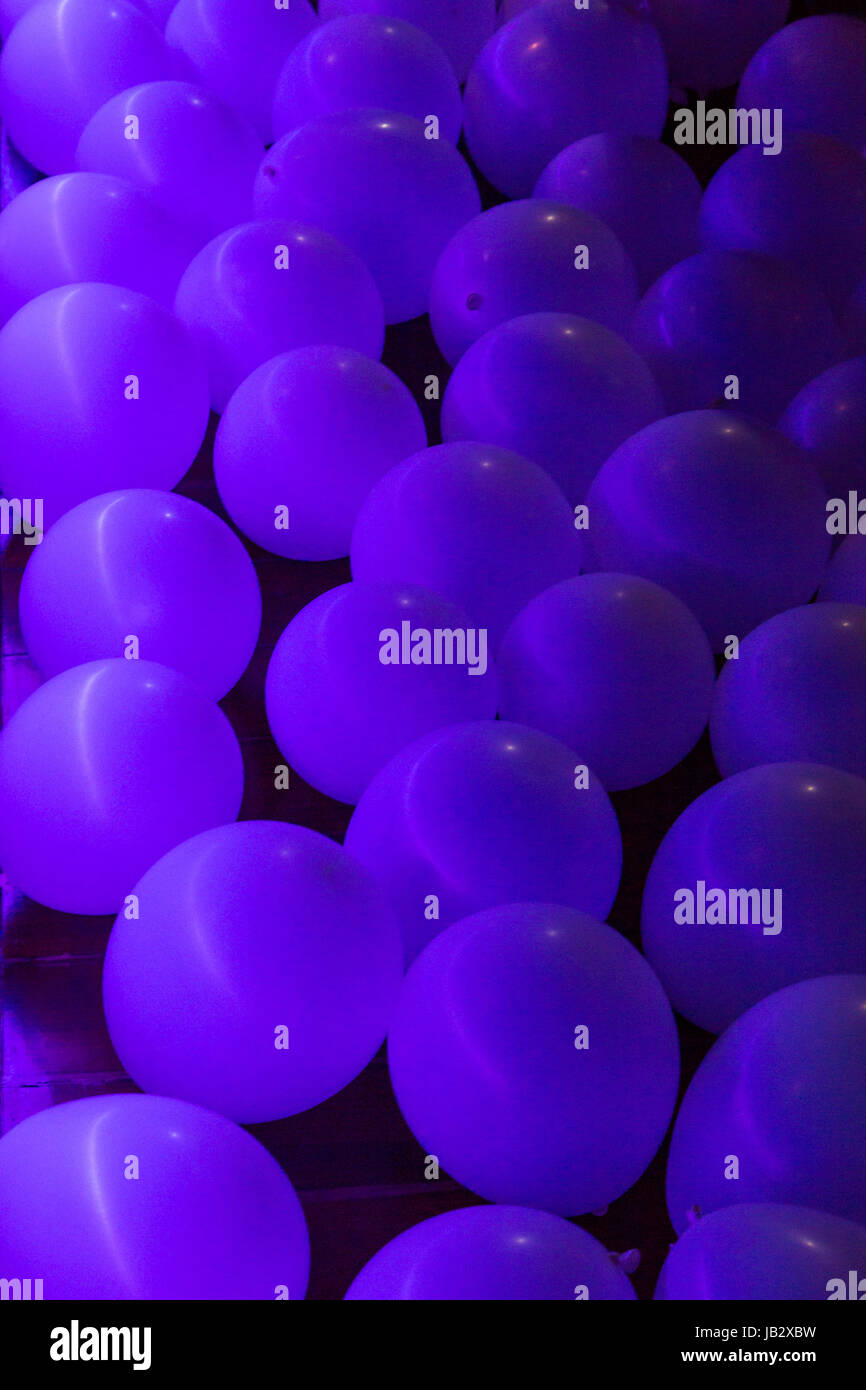 balloons in dark blue lighting on floor in a night club for event