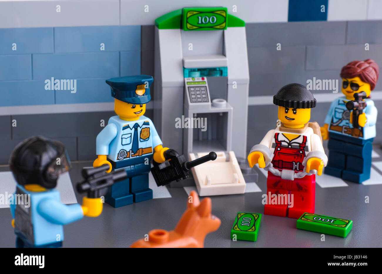Tambov, Russian Federation - June 03, 2017 Lego policemen arrested thief who hack ATM. Studio shot. - Stock Image