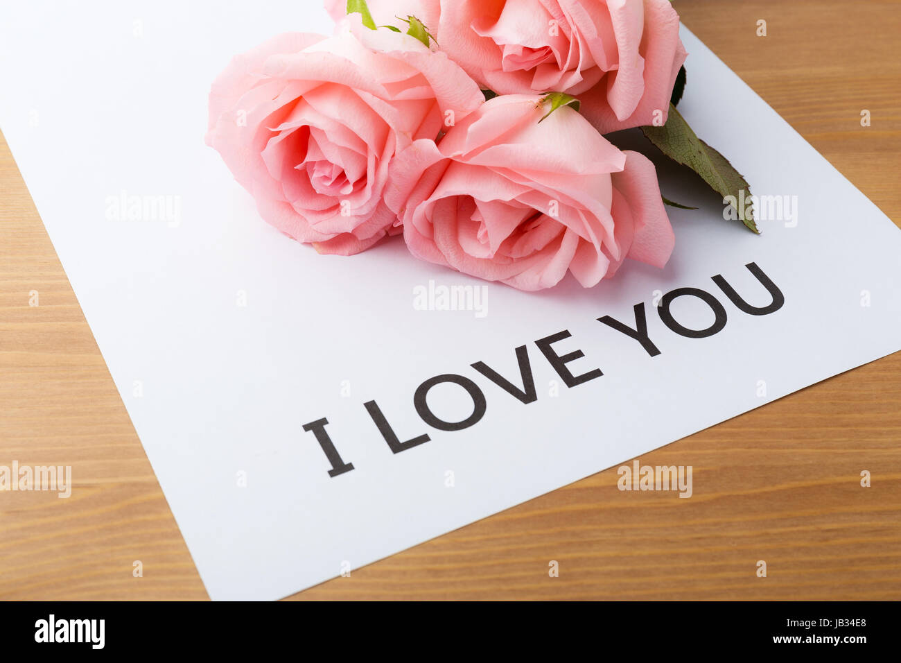 Pink Rose And Gift Card Of Message I Love You Stock Photo Alamy