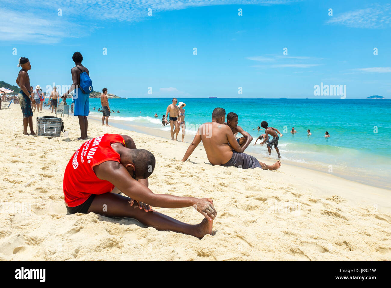 RIO DE JANEIRO - FEBRUARY 05, 2017: Muscular young carioca Brazilian lifeguard does his morning fitness routine - Stock Image