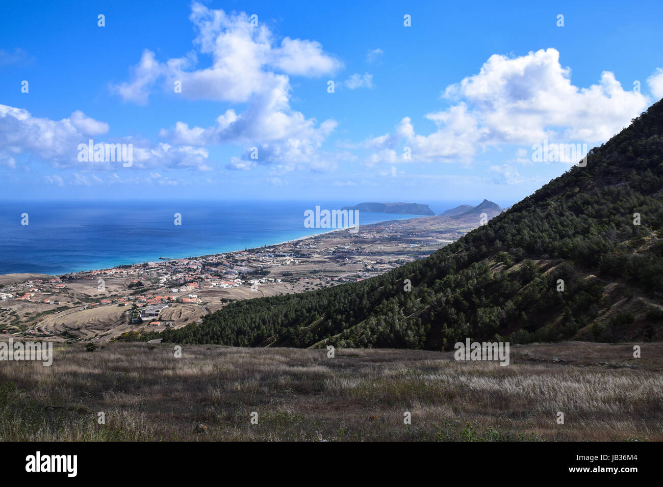View of Vila Baleira, Porto Santo Island with Ilheu da Cal on the horizon - Stock Image