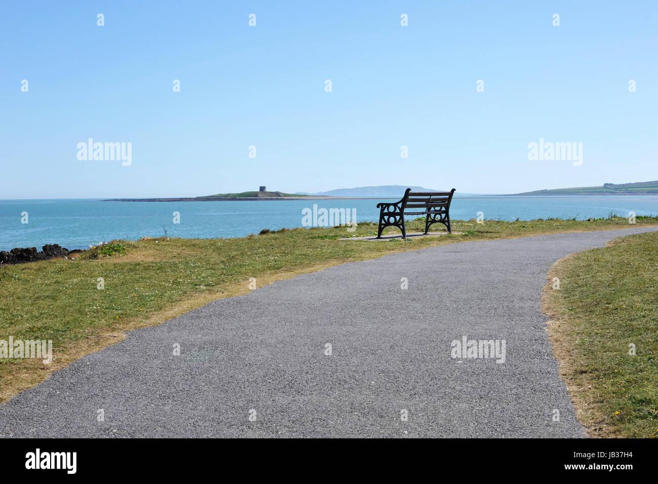Empty bench overlooking on irish sea at Skerries, county Dublin, Ireland - Stock Image