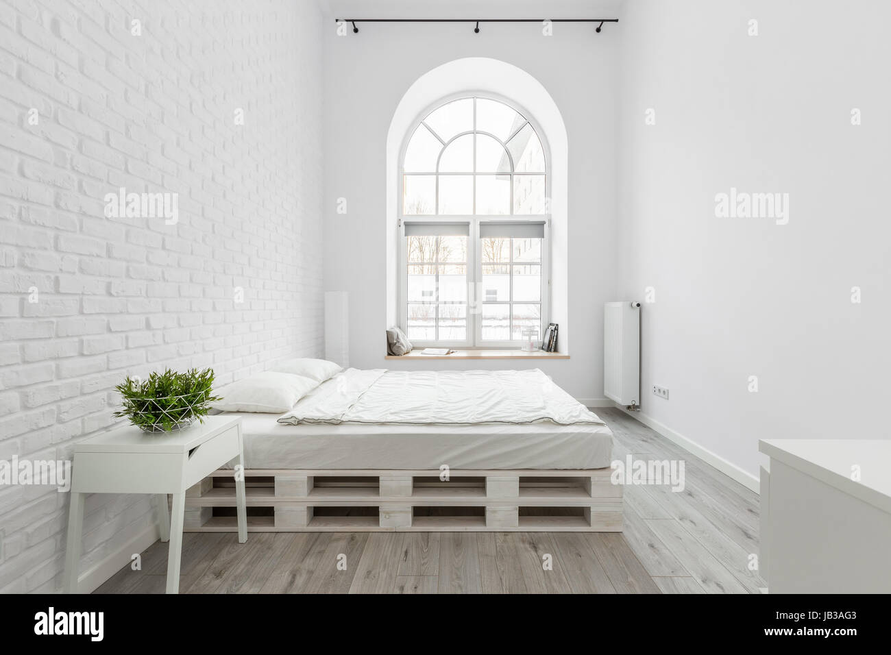 half circle window motorized loft bedroom with white brick wall pallet bed and half circle window