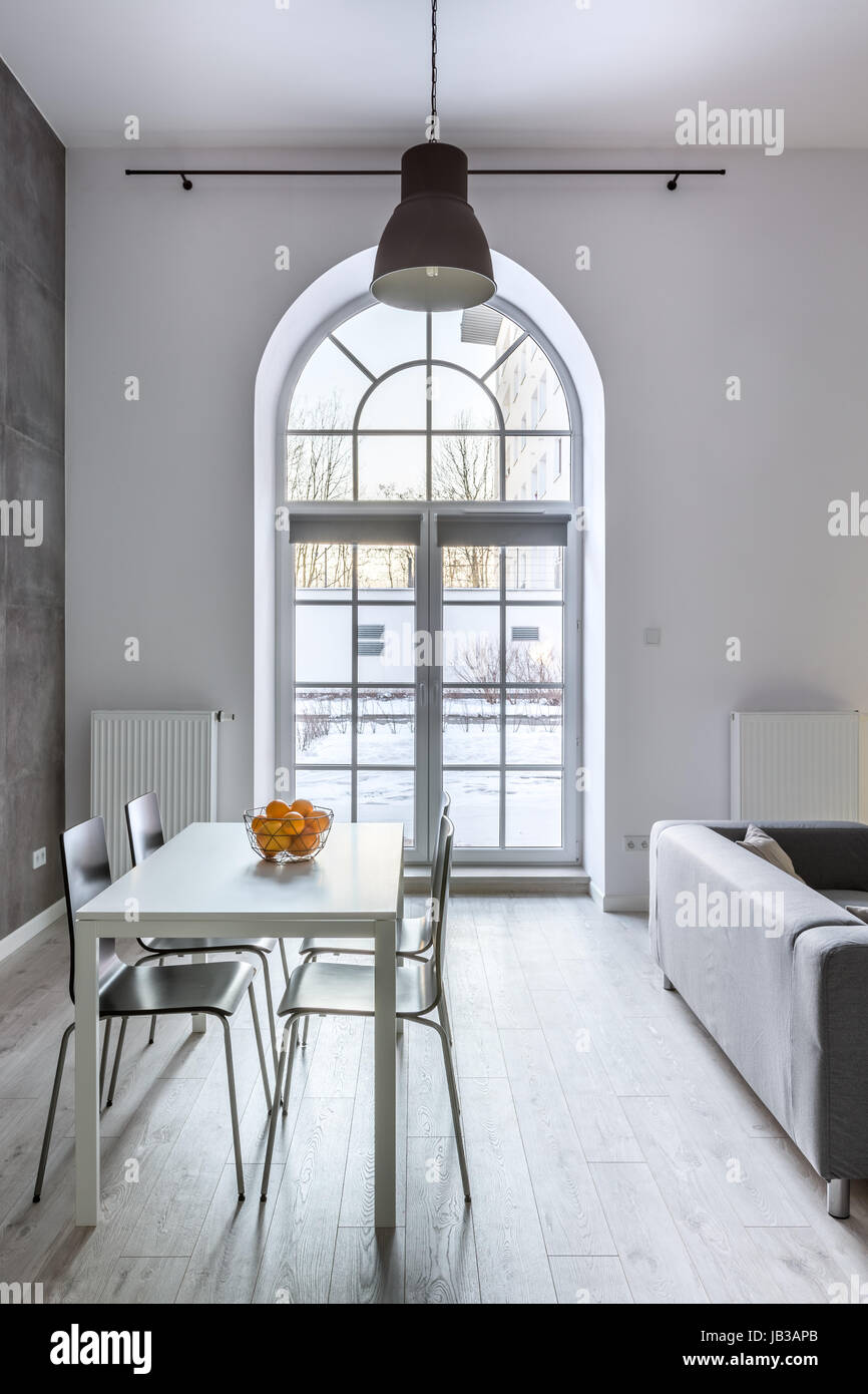 half circle window design white loft interior with half circle window dining table and chairs