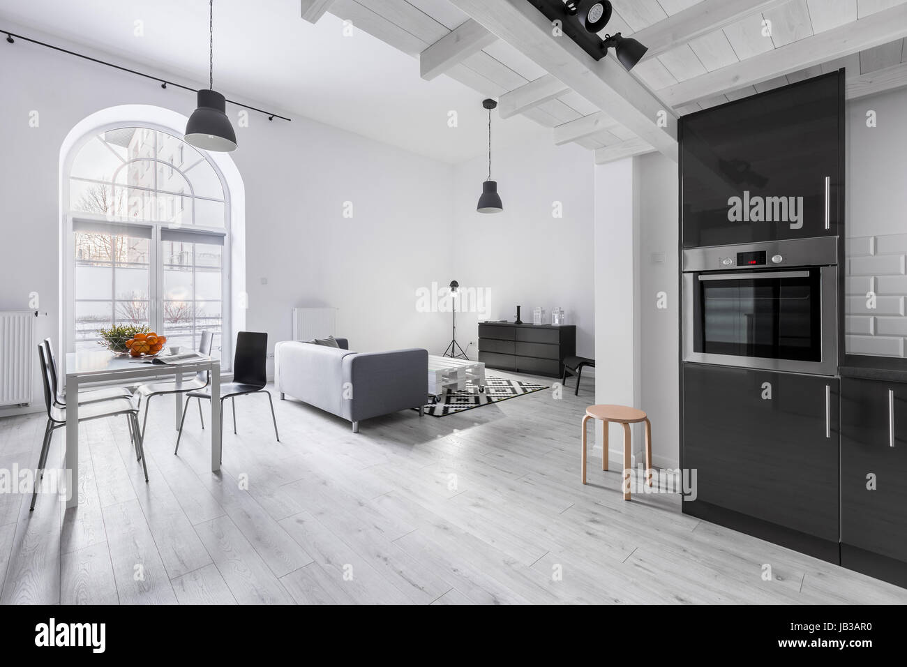 Modern apartment in industrial style with kitchen and open living ...