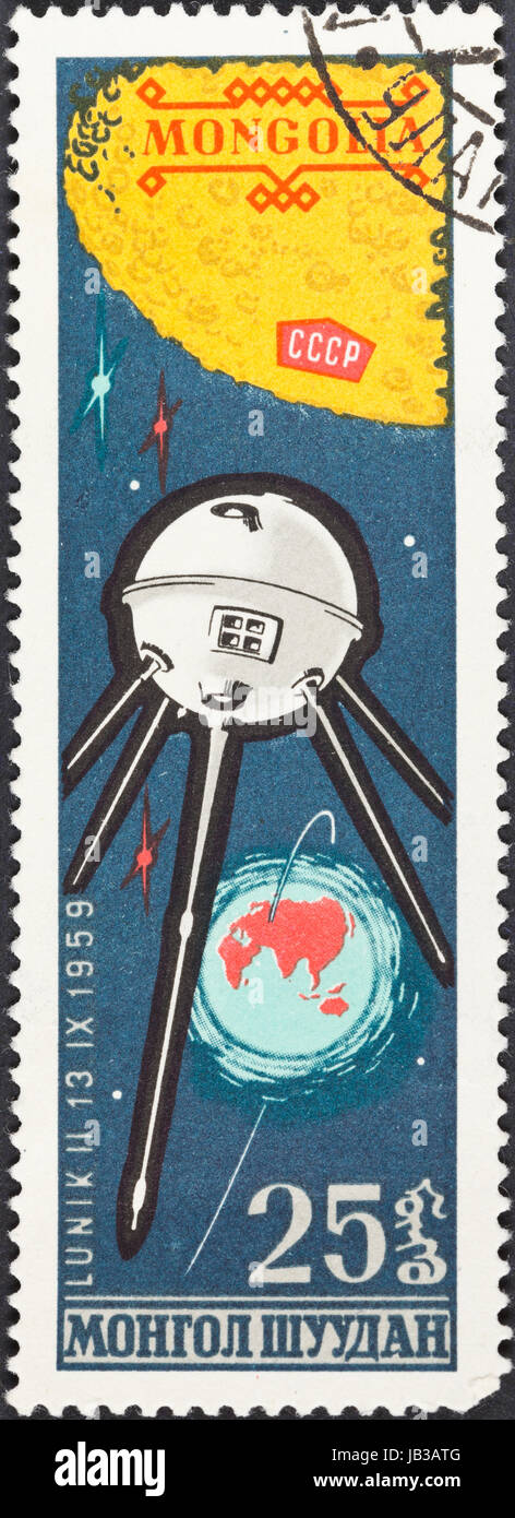 MONGOLIA - CIRCA 1963: A postage stamp printed in the Mongolia shows Automatic interplanetary station Luna 2 first - Stock Image