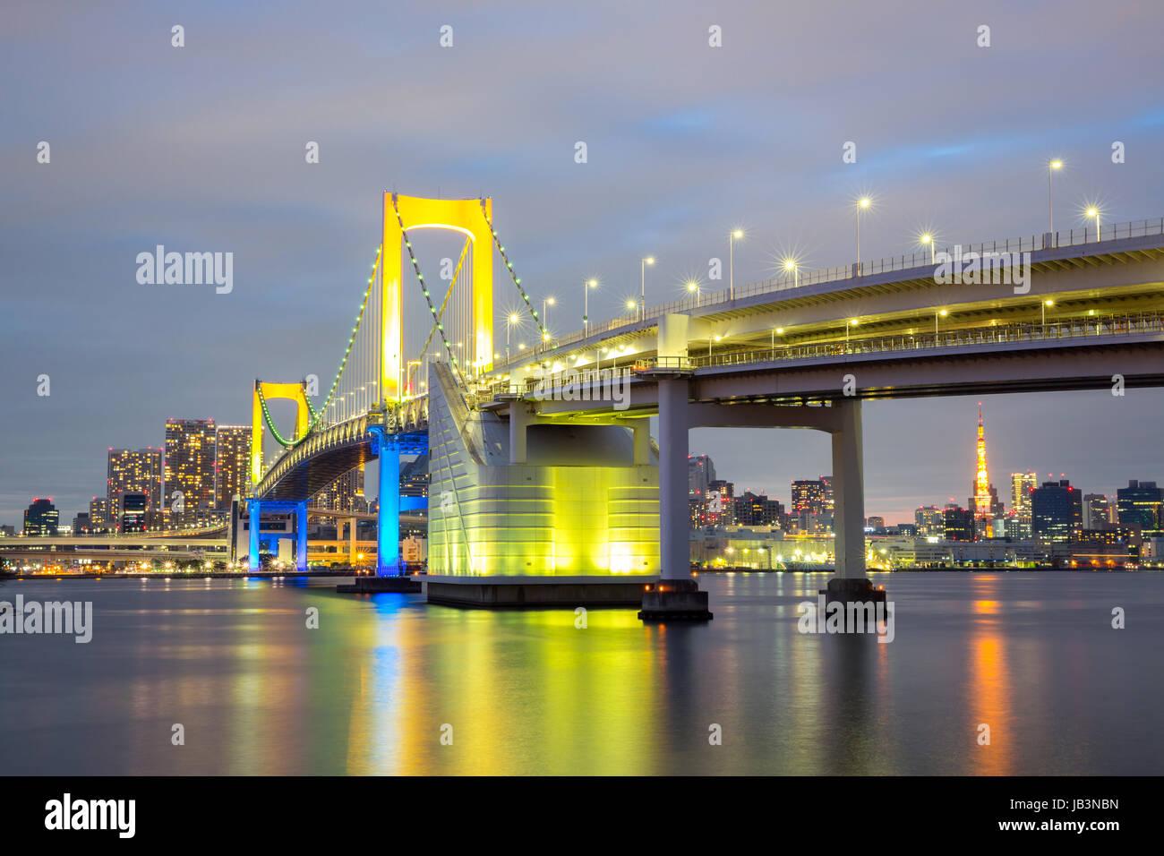 Rainbow bridge from Odaiba Tokyo at dusk in Japan Stock Photo