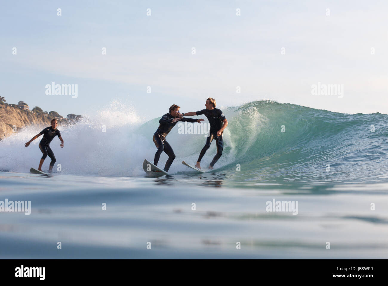Overcrowded waves in Southern California lead two surfers to engage in a fistfight while surfing at Black's Beach. Stock Photo