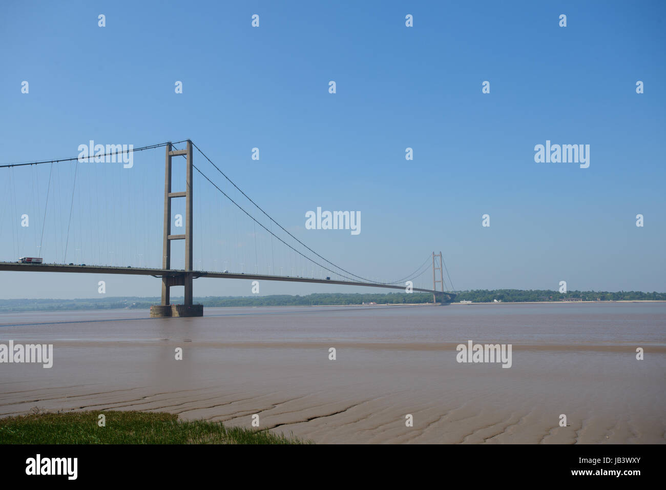 Stock photograph:  The Humber Bridge seen from Barton Upon Humber on a sunny day.  Picture: Chris Vaughan Photography - Stock Image