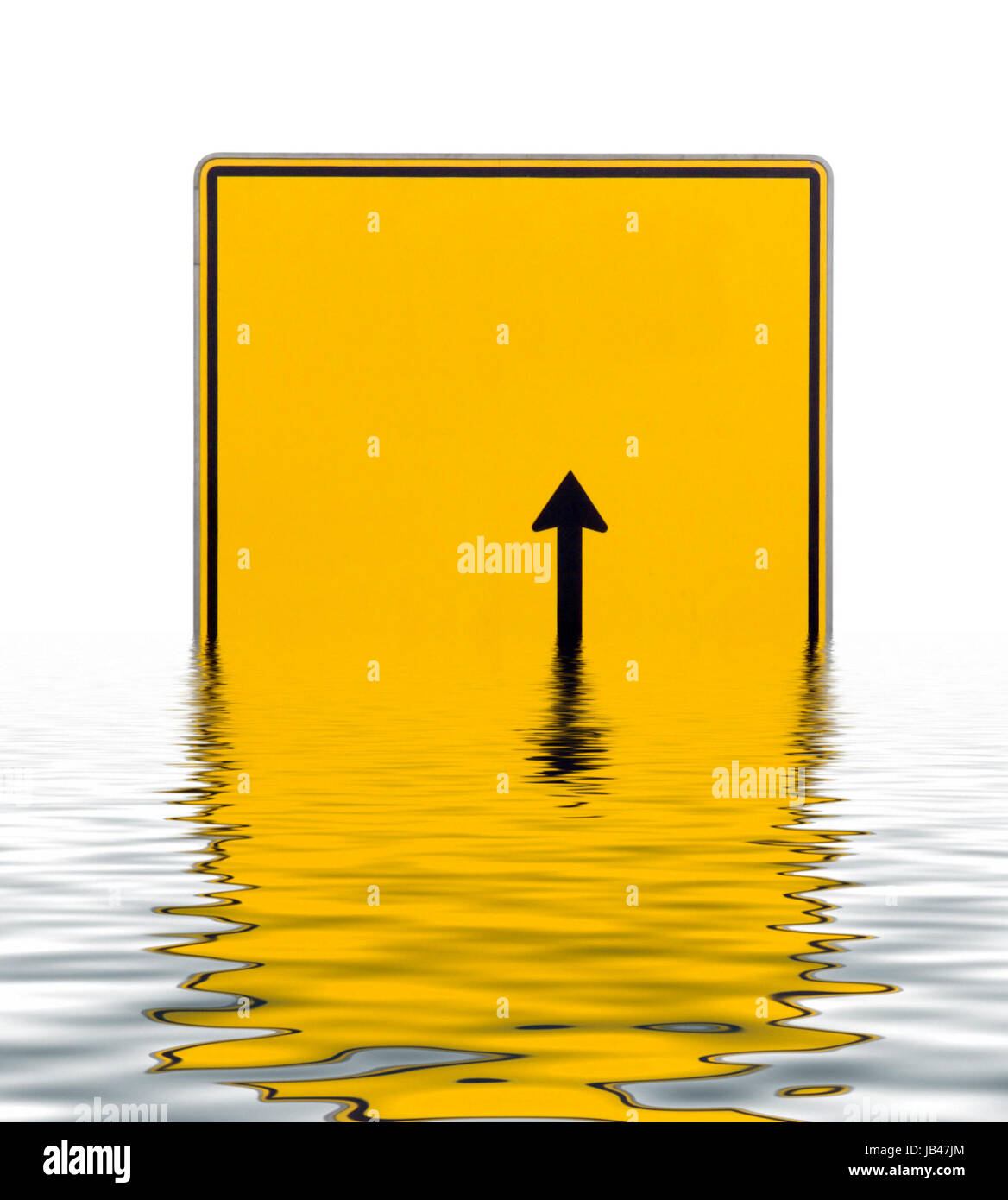 yellow blank direction signpost with black arrow on reflective water surface in white back - Stock Image