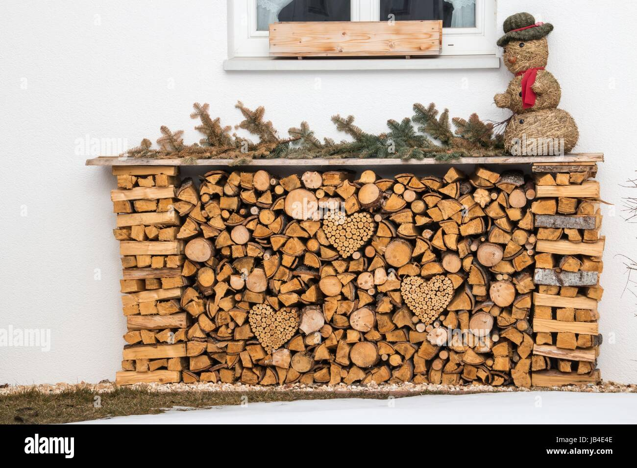 herzförmiges holzstoss - Stock Image