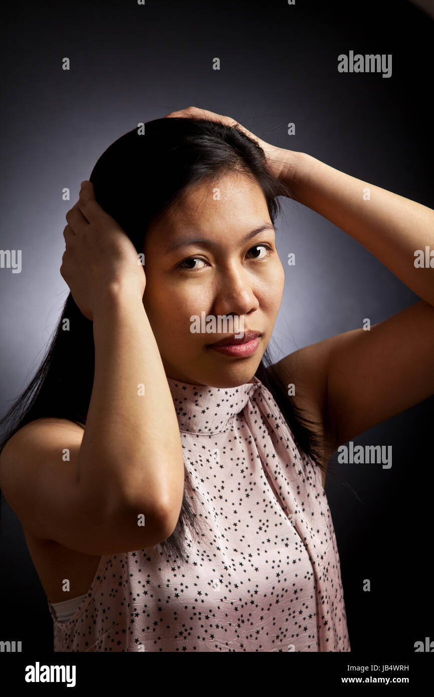 Portrait of a cute young  asian girl in studio - Stock Image
