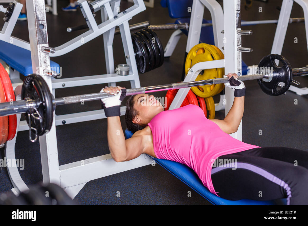 Sports Young Woman Doing Exercises With Barbell On Bench In The Gym Stock Photo Alamy