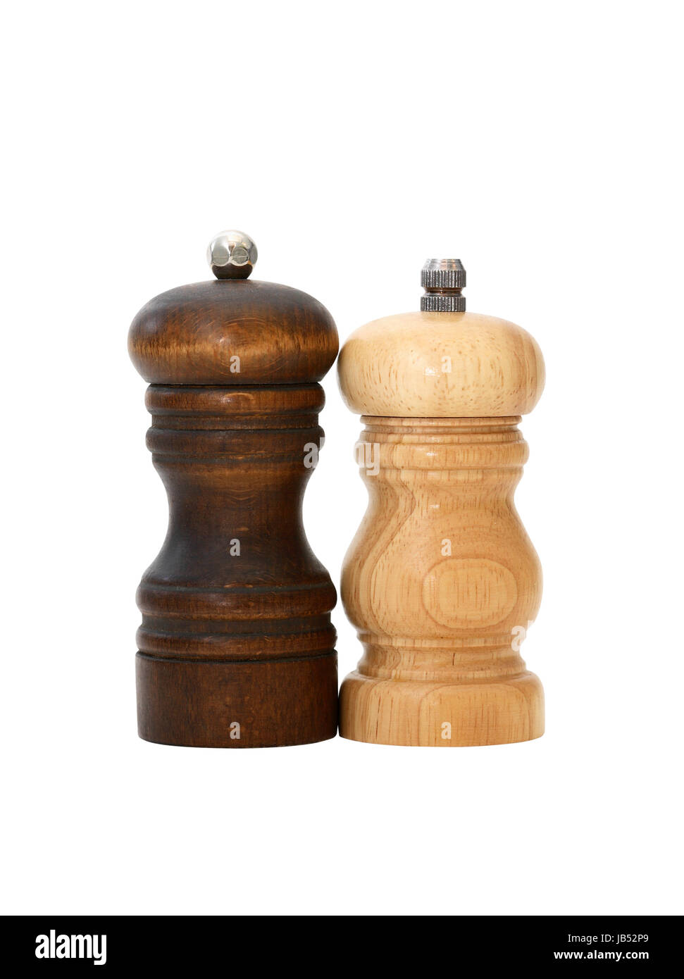 Pair of vintage wooden pepper mills on white background. Isolated with clipping path - Stock Image