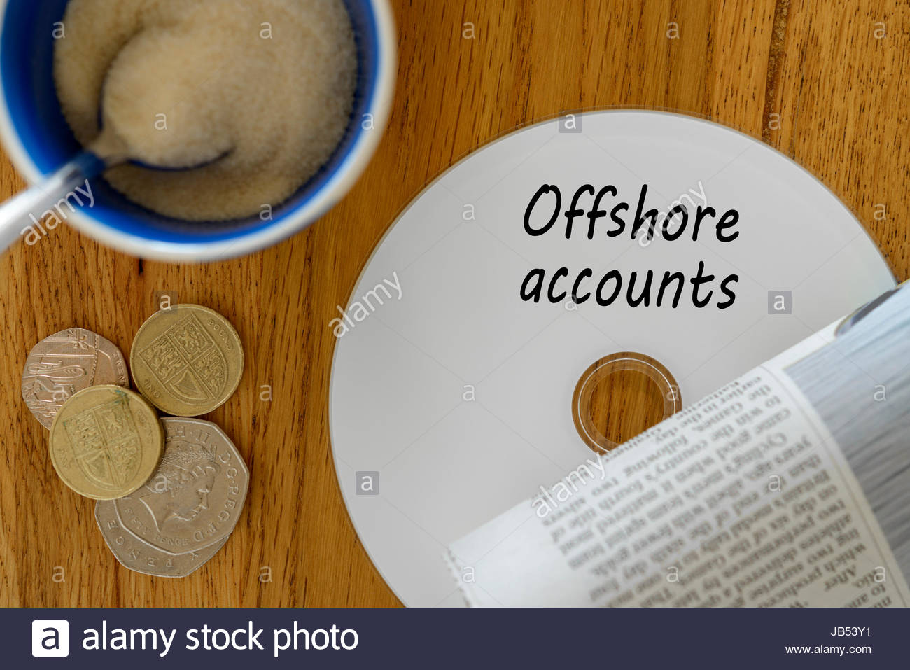 Offshore accounts, data disc left on cafe table, Dorset, England. - Stock Image