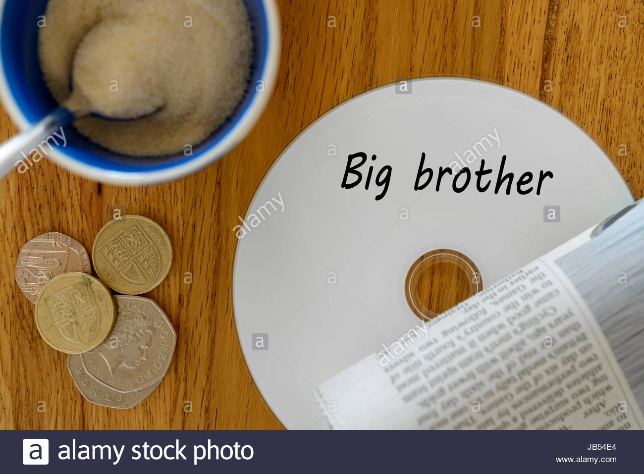 Big brother, data disc left on cafe table, Dorset, England. - Stock Image