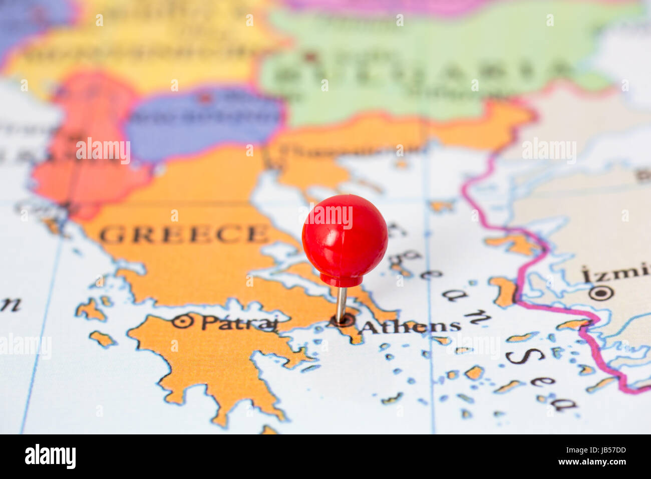 Round Red Thumb Tack Pinched Through City Of Athens On Greece Map