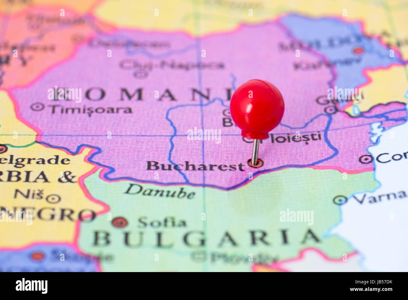 Round red thumb tack pinched through city of Bucharest on ...
