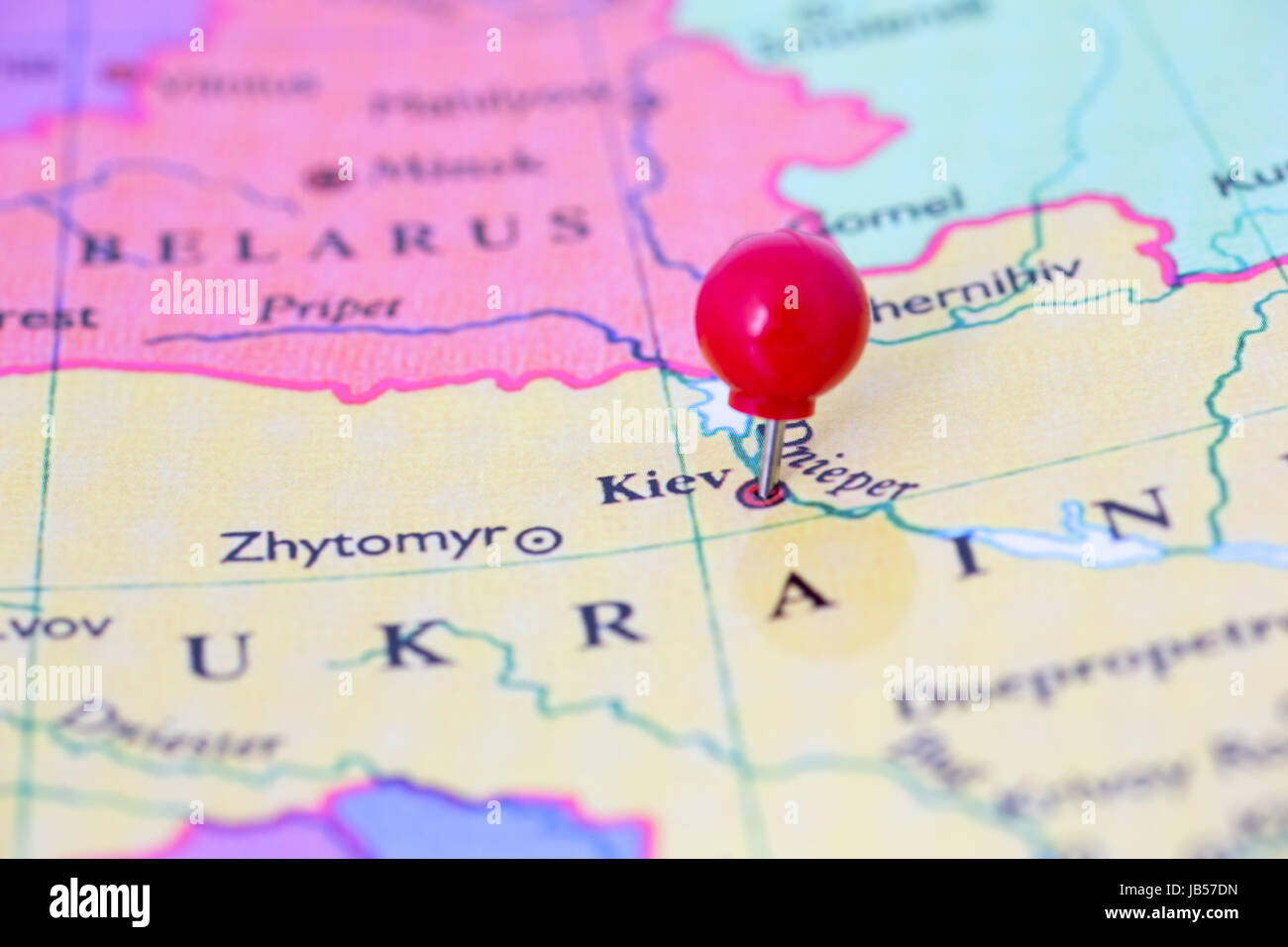 Round Red Thumb Tack Pinched Through City Of Kiev On Ukraine Map
