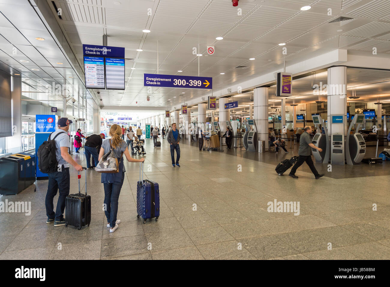 Montreal, CANADA - 8 June 2017: Passengers walking to departure gate at Pierre Elliott Trudeau International Airport - Stock Image