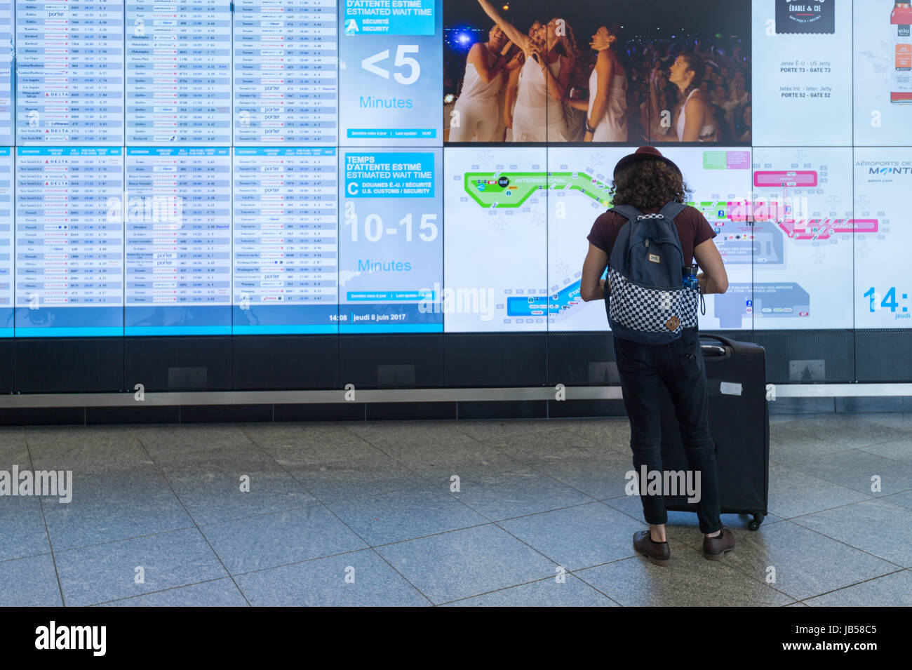 Montreal, CANADA - 8 June 2017: Passenger checking schedules at Pierre Elliott Trudeau International Airport - Stock Image