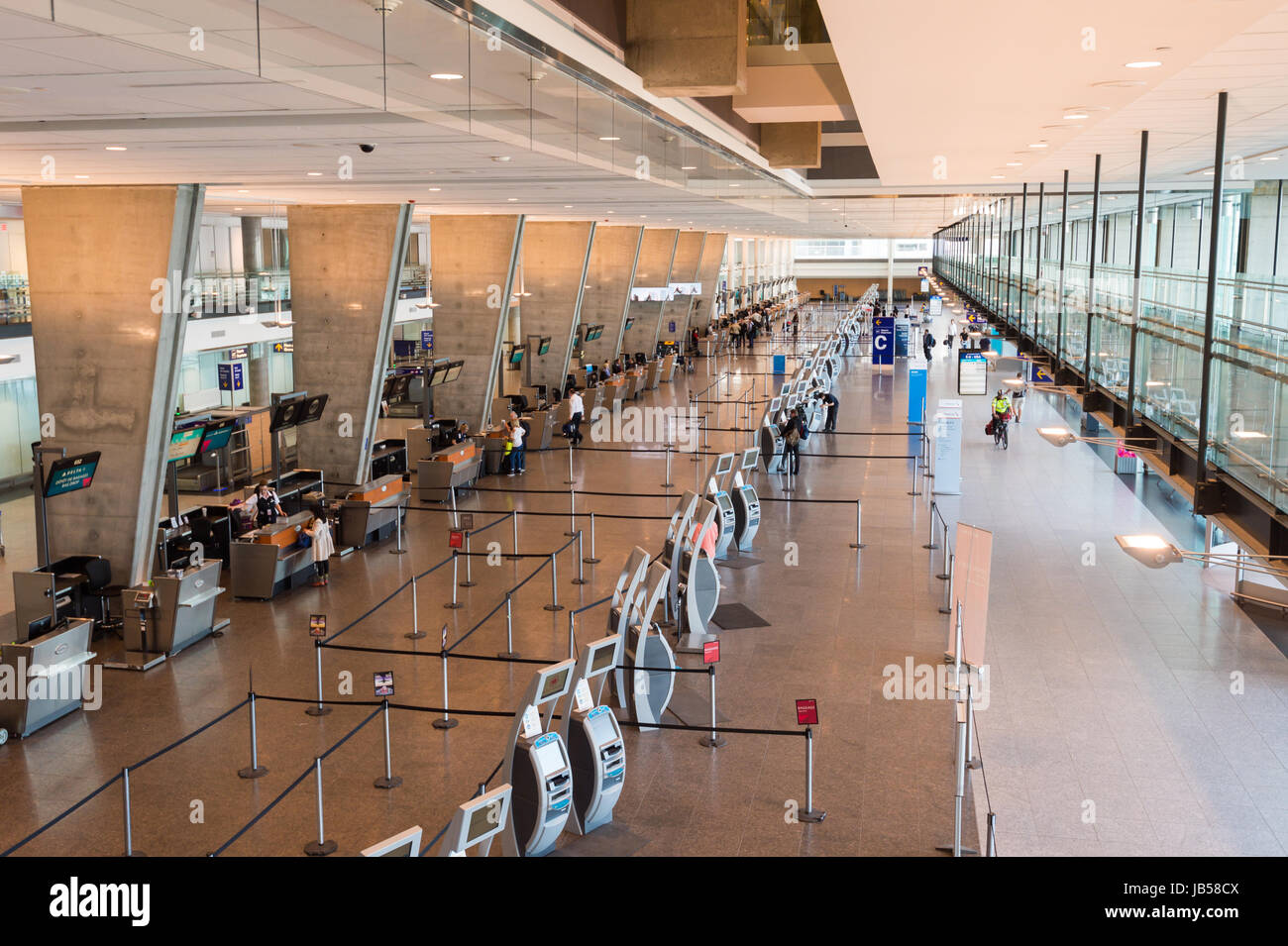 Montreal, CANADA - 8 June 2017: Check-in counters at Pierre Elliott Trudeau International airport. - Stock Image