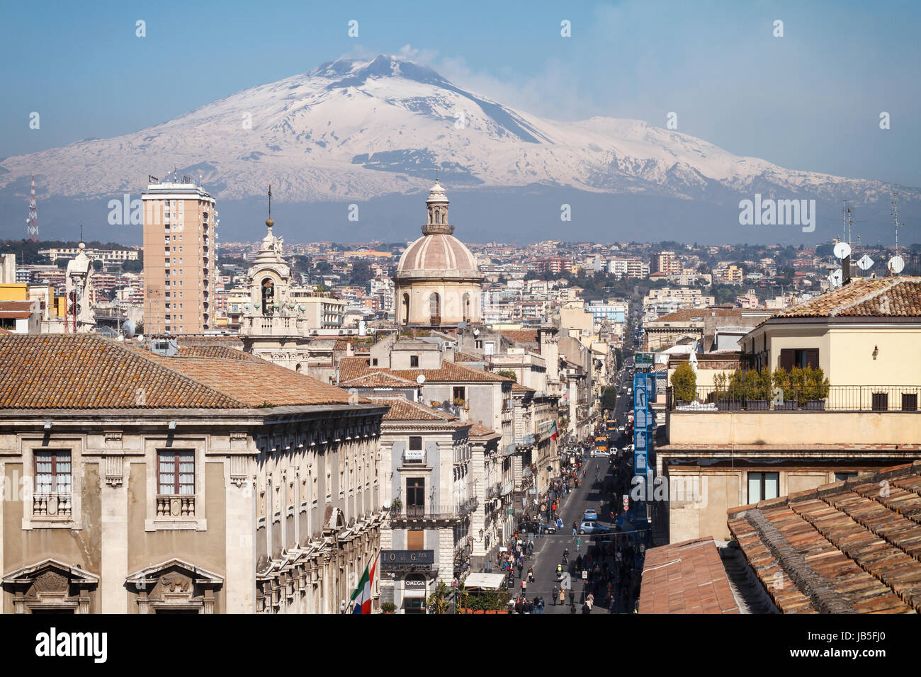 Catania, the central 'Via Etnea' street with the snow covered Mount Etna volcano, Sicily, Italy. - Stock Image