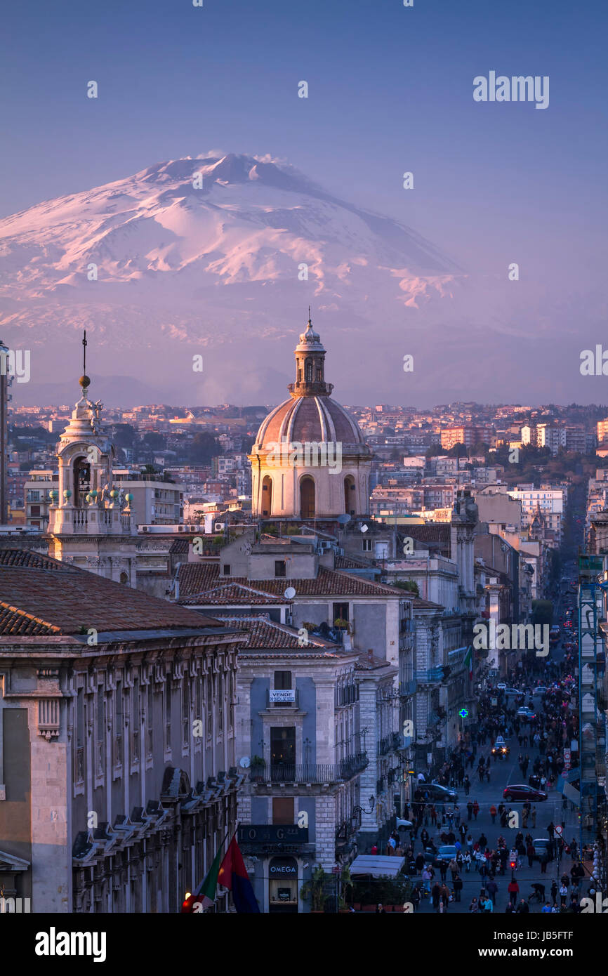 Catania, the city center with Mt. Etna volcano, covered with snow, on the background, Sicily, Italy. - Stock Image