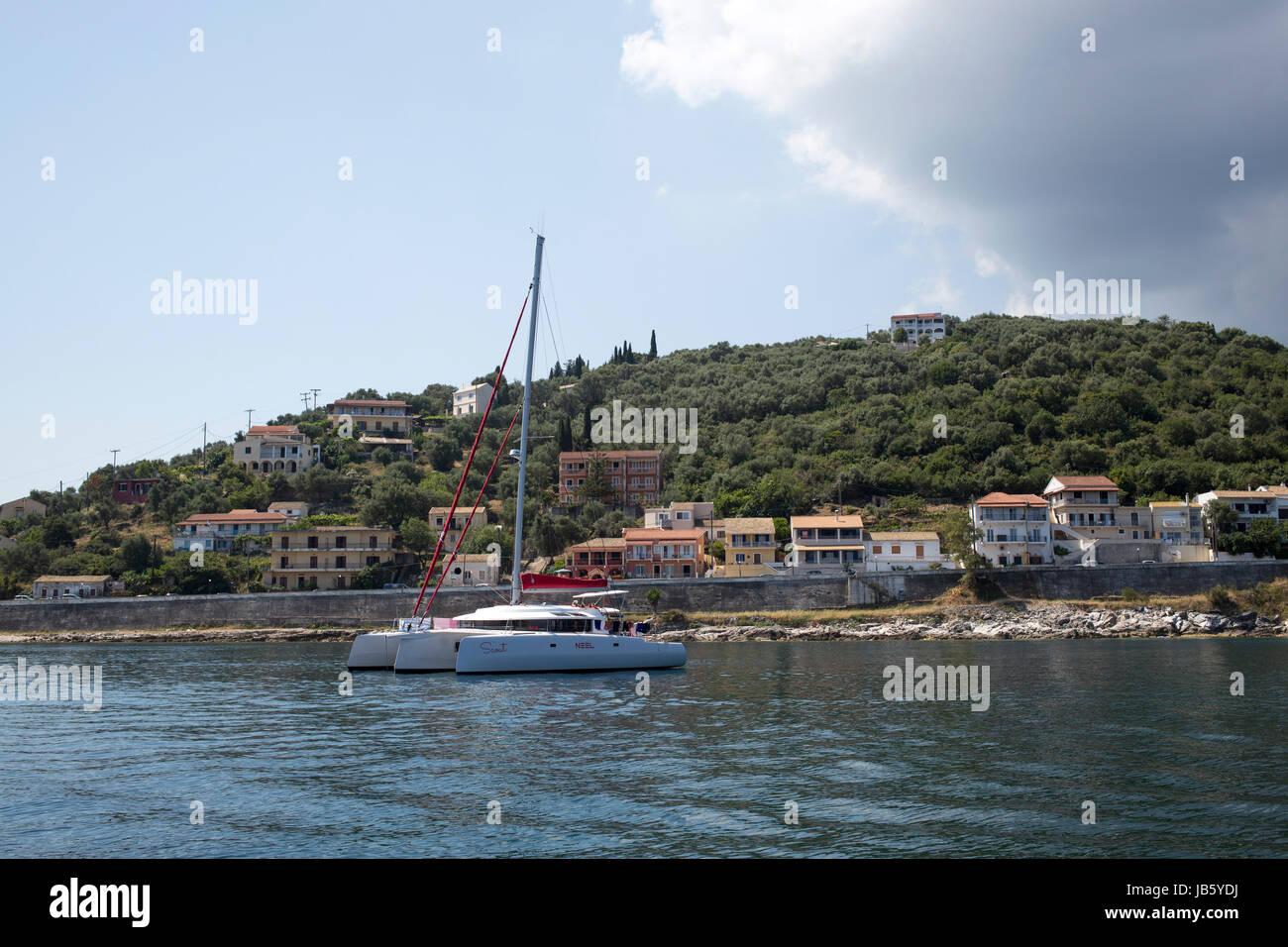 Neel 45 trimaran at anchor in Kassiopi, Corfu - Stock Image