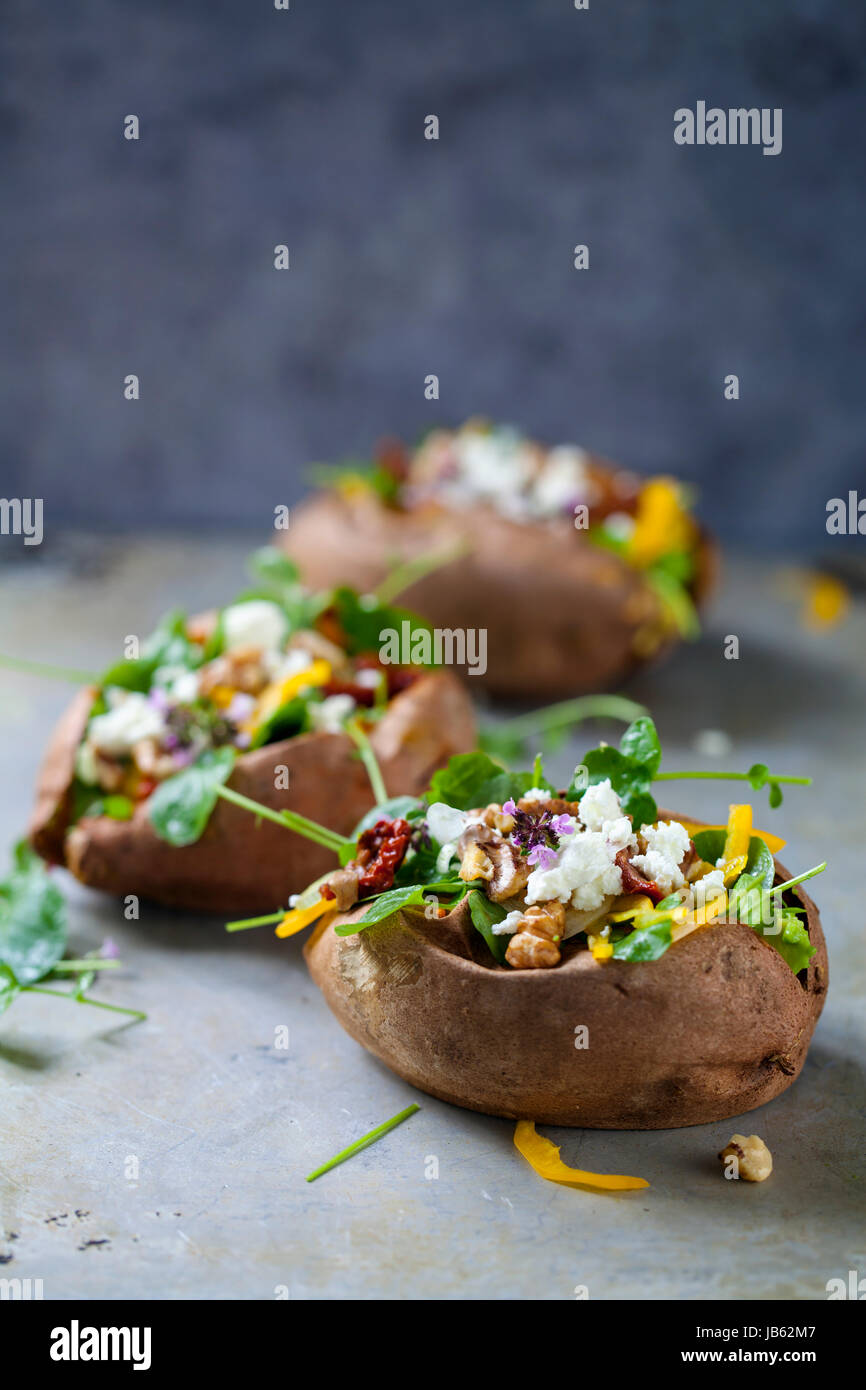 Baked sweet potato with salad - Stock Image